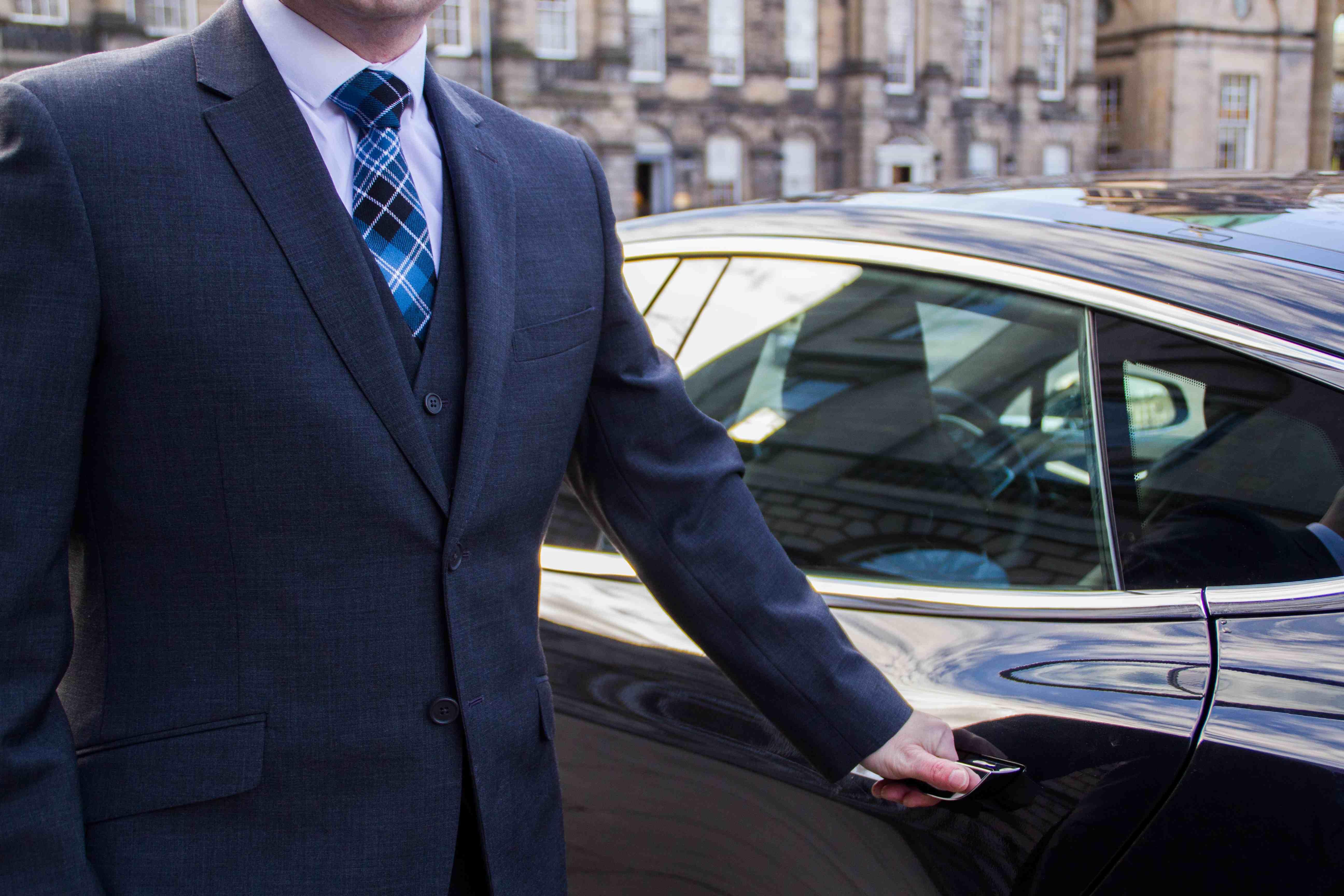 Ecosse EV Chauffeur next to Tesla Edinburgh