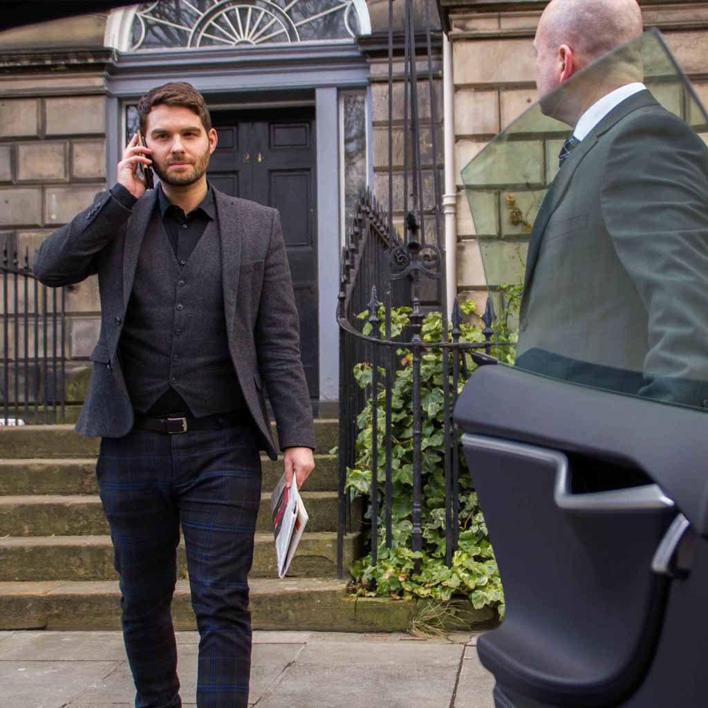 Edinburgh Chauffeur opening door