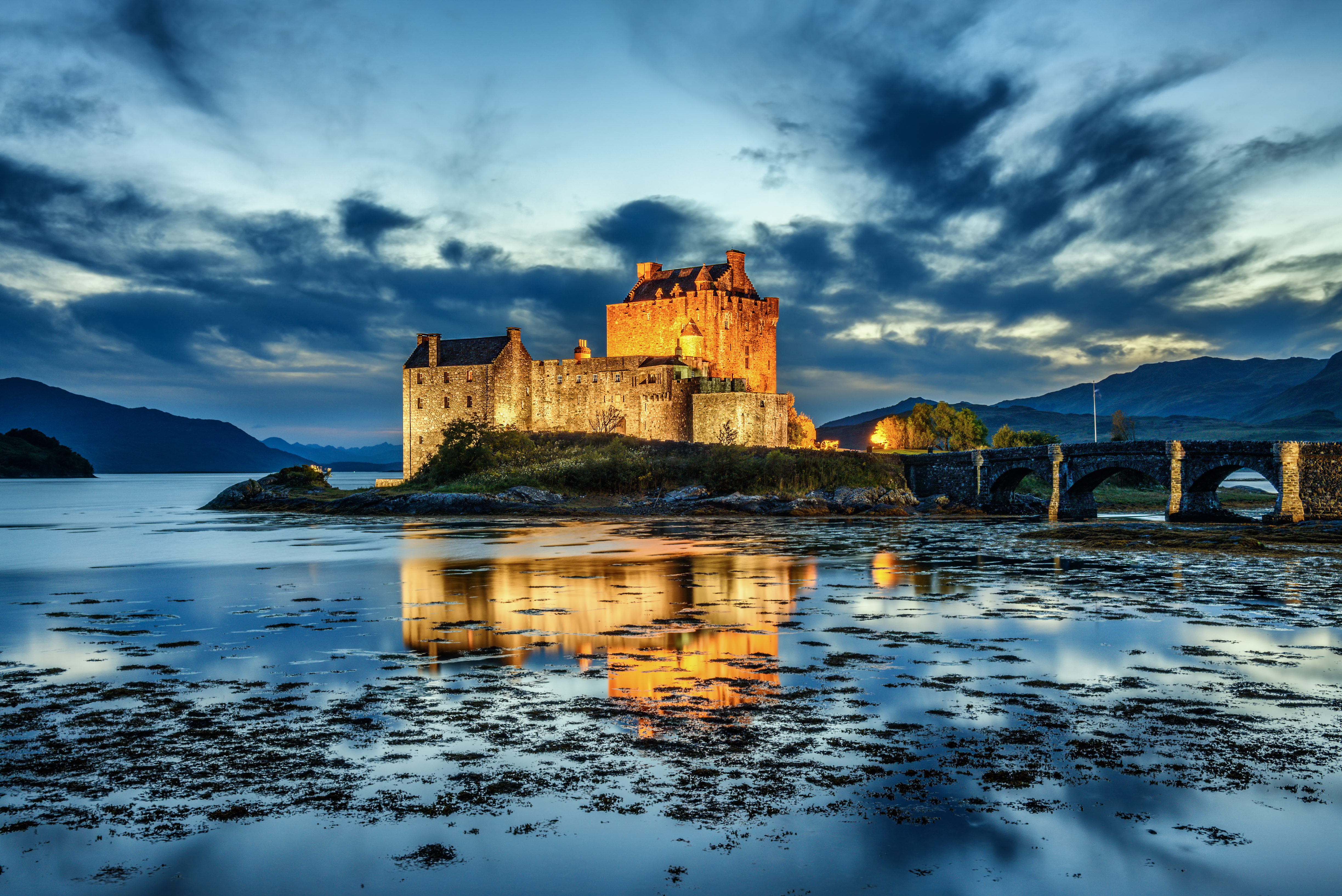 Eilean Donan Castle during blue hour after sunset. Eilean Donan is recognised as one of the most iconic places of Scotland, United Kingdom