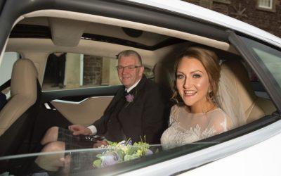 Bride in Ecosse EV Tesla Wedding Car